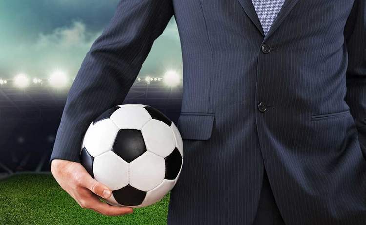 Businessman with football