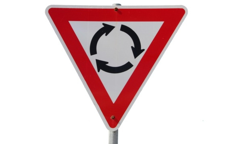 A roundabout sign