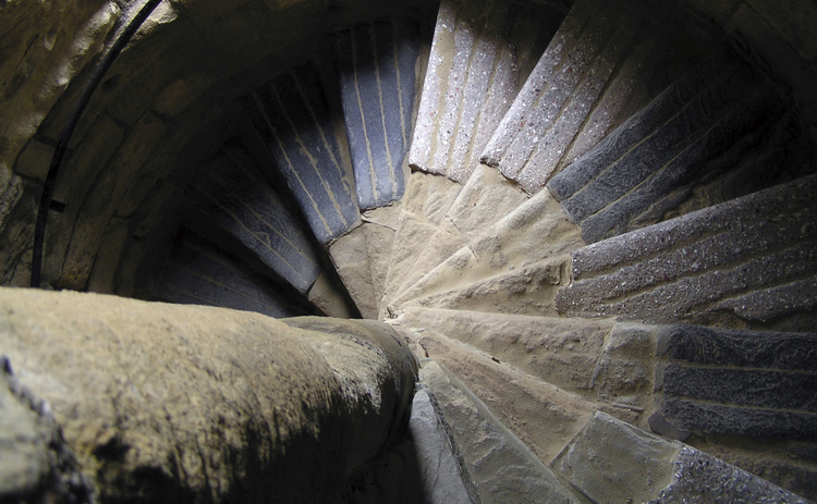 old-stone-spiral-staircase-looking-downwards