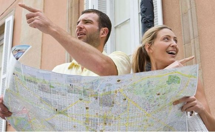 tourists checking directions on map