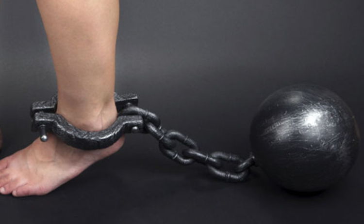 A ball and chain shackling an ankle