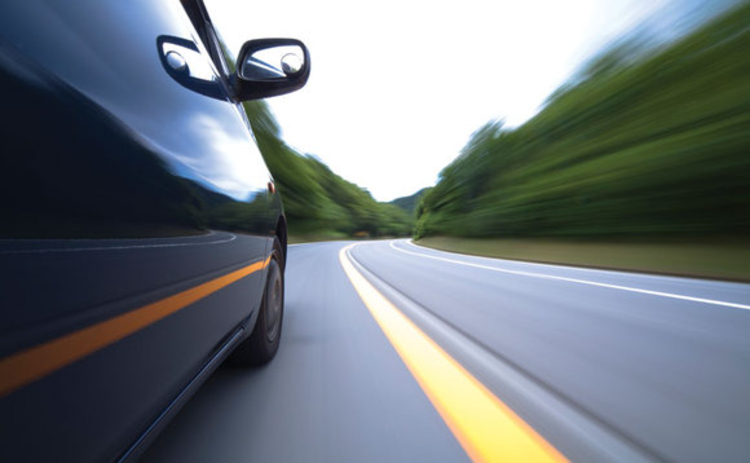 Close up of a car travelling fast on a road