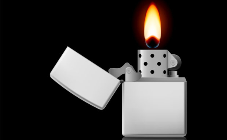 A lighter with a flame on a black background