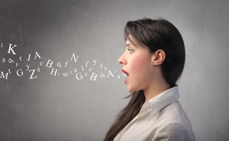 Letters coming out of a woman's mouth