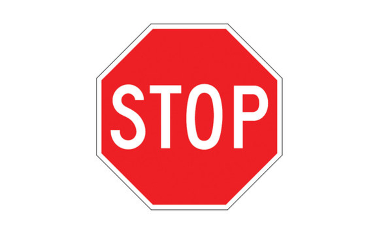 UK stop sign - the word STOP in white on a octagonal red background