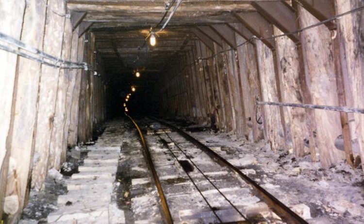 Entrance to a coal mine with cart tracks