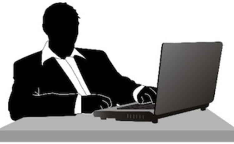 guy-in-suit-at-computer