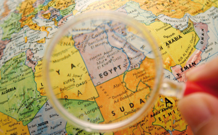 Egypt and Sudan on a globe under a magnifying glass