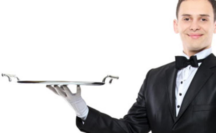 A waiter holding a serving tray