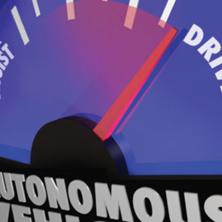 An autonomous vehicle dial with the needle pointing more towards self-driving than driver assist